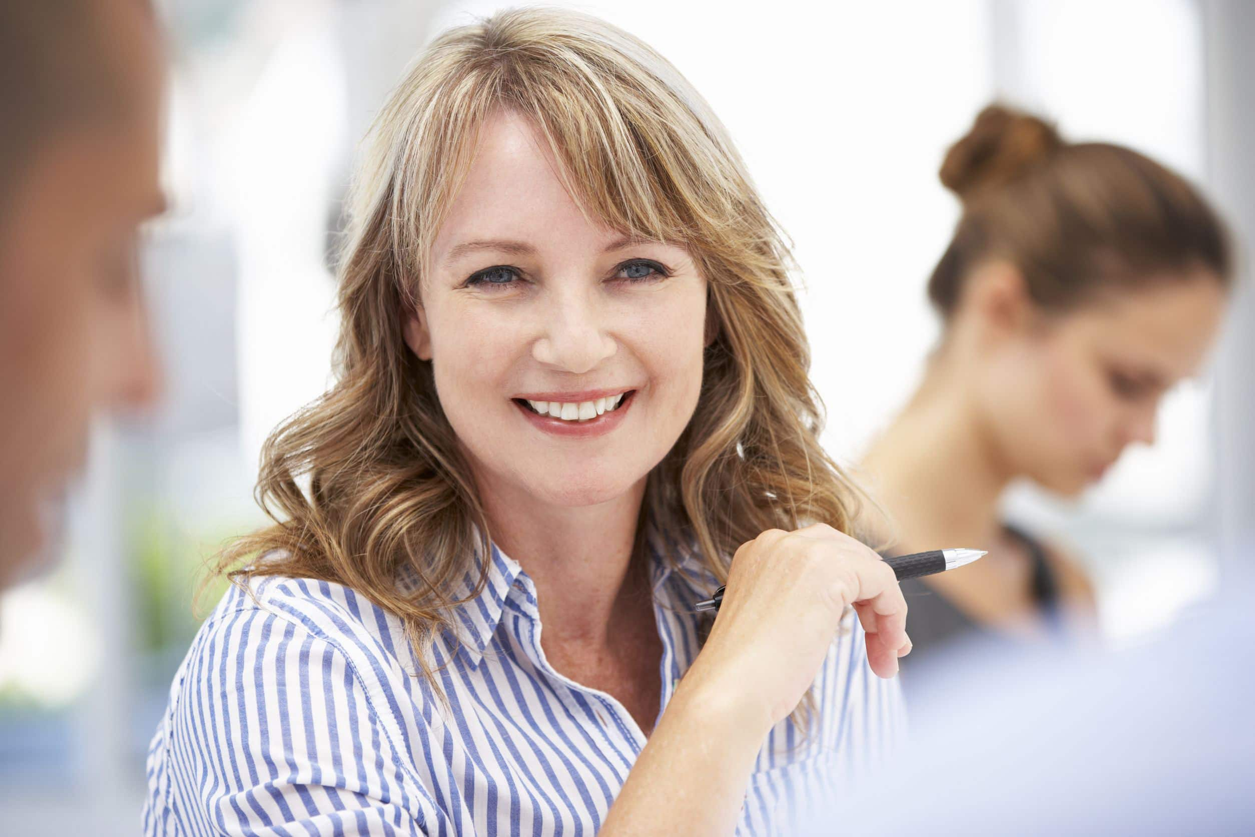 woman in business meeting smiling